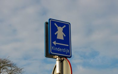 A Road Sign Pointing To Kinderdijk