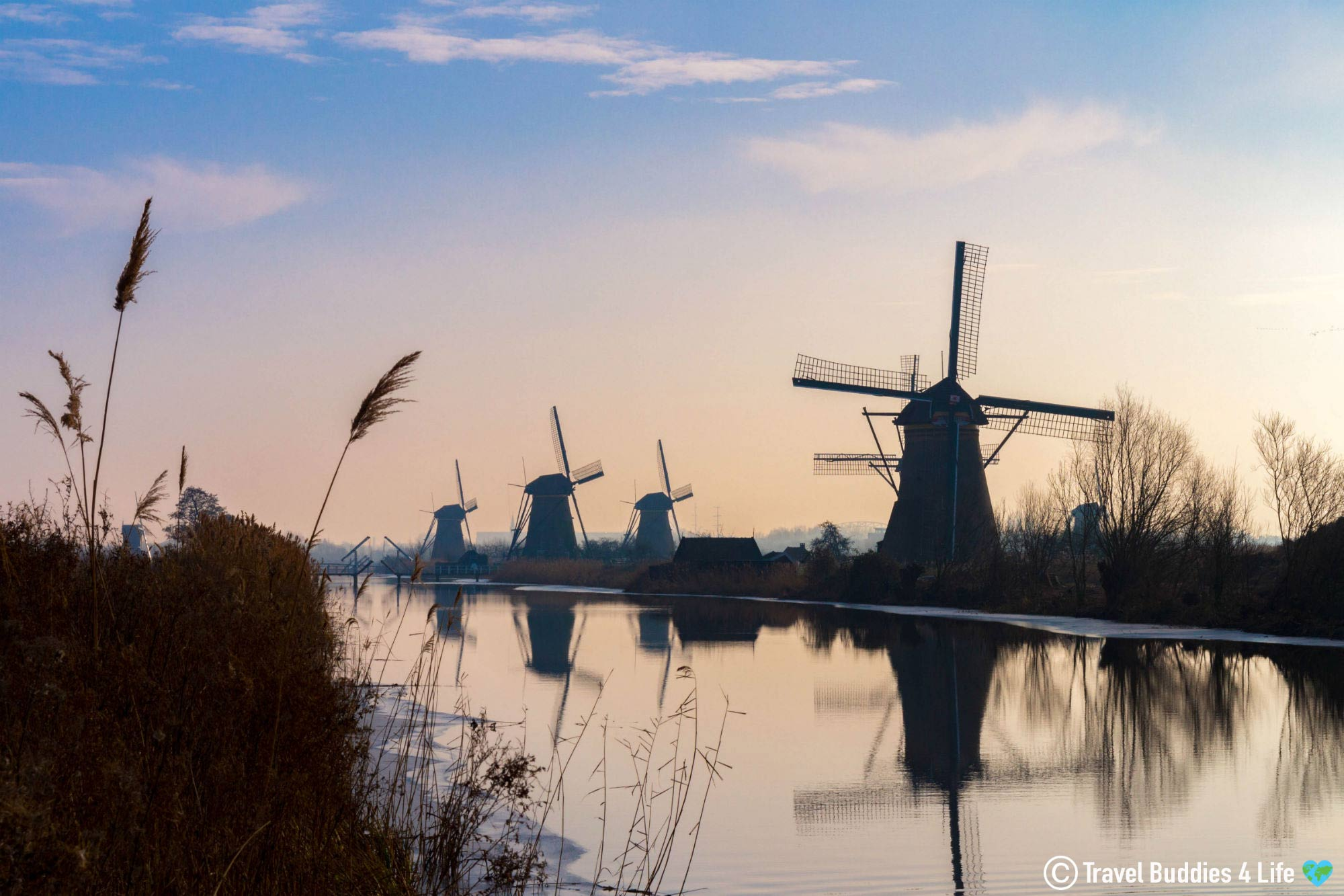 A Watercolour Pink Sky And The Contour Of Kinderdijk Windmills In The Netherlands, Europe