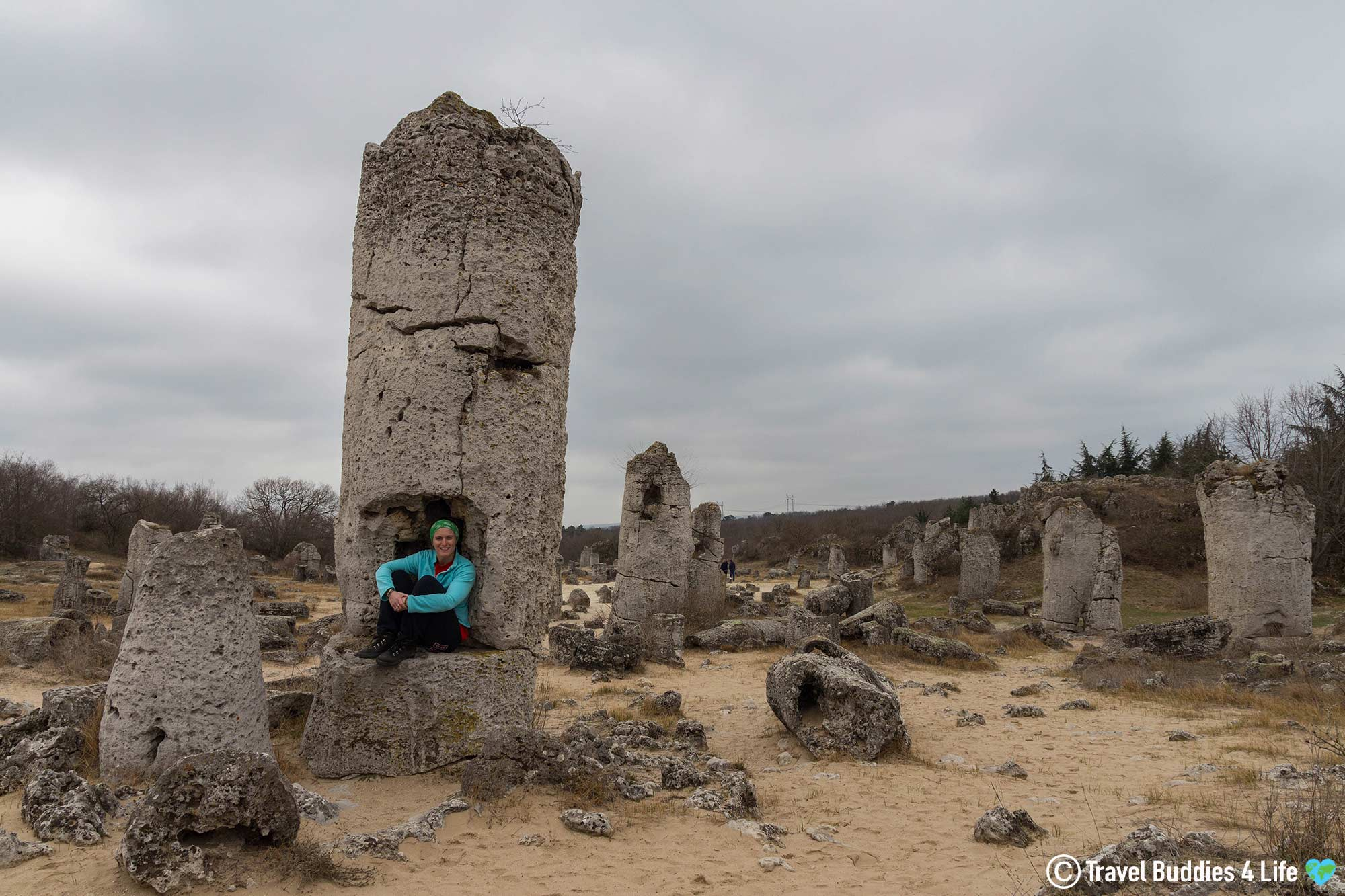 Ali Sitting In A Rock Formation At The Stone Desert In Bulgaria, Traveling Europe