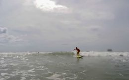 Ali Surfing in the Distance
