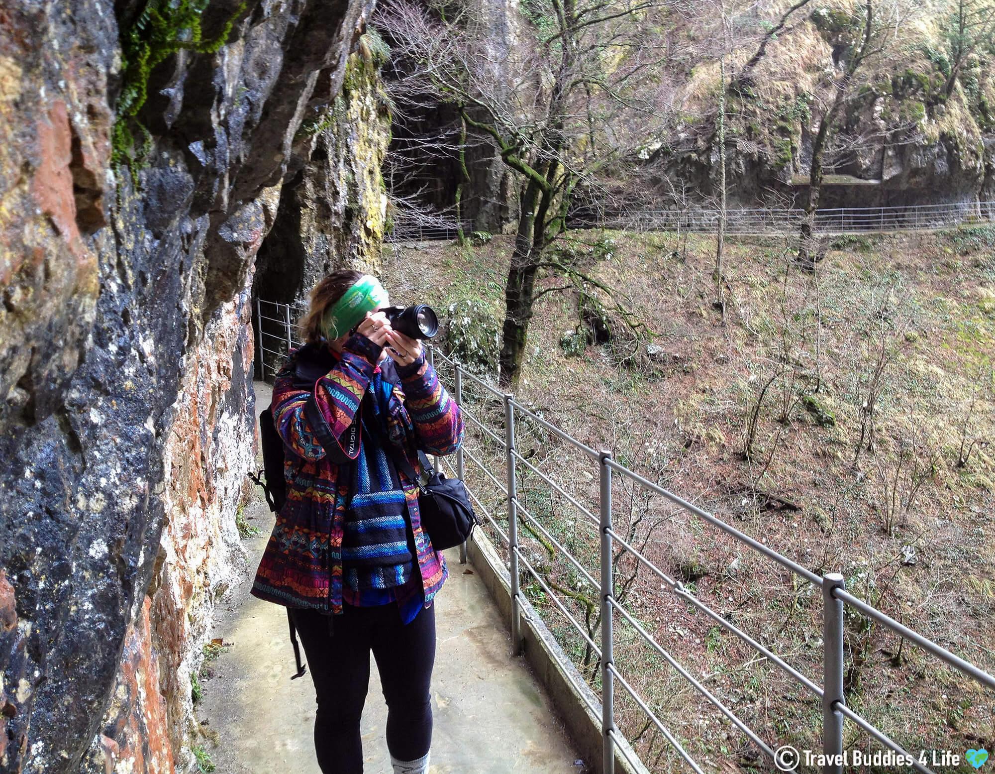 Ali Taking a Picture Outside of the Skocjanske Jame Caves of Slovenia's Karst Region, in Europe's Balkan Countries