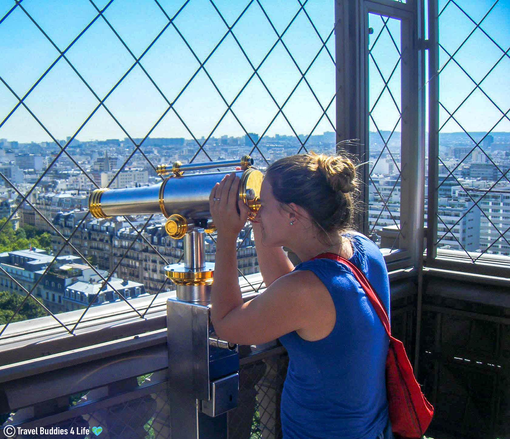 Ali Using The Spyglass Of The Eiffel Tower To Gaze Out At The Surroundings Of Paris, France, Europe