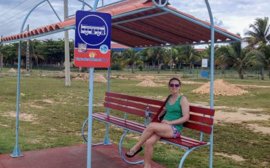 Ali Waiting for the Bus in Cuba