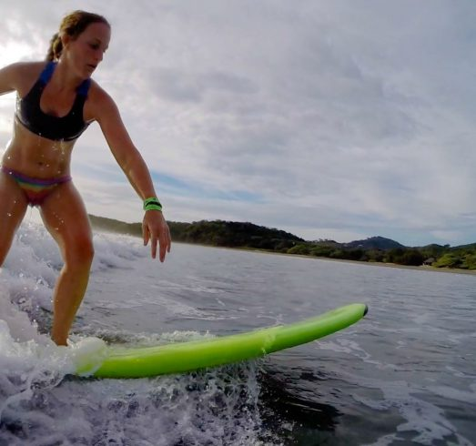 Ali Whizzing by on Her Board