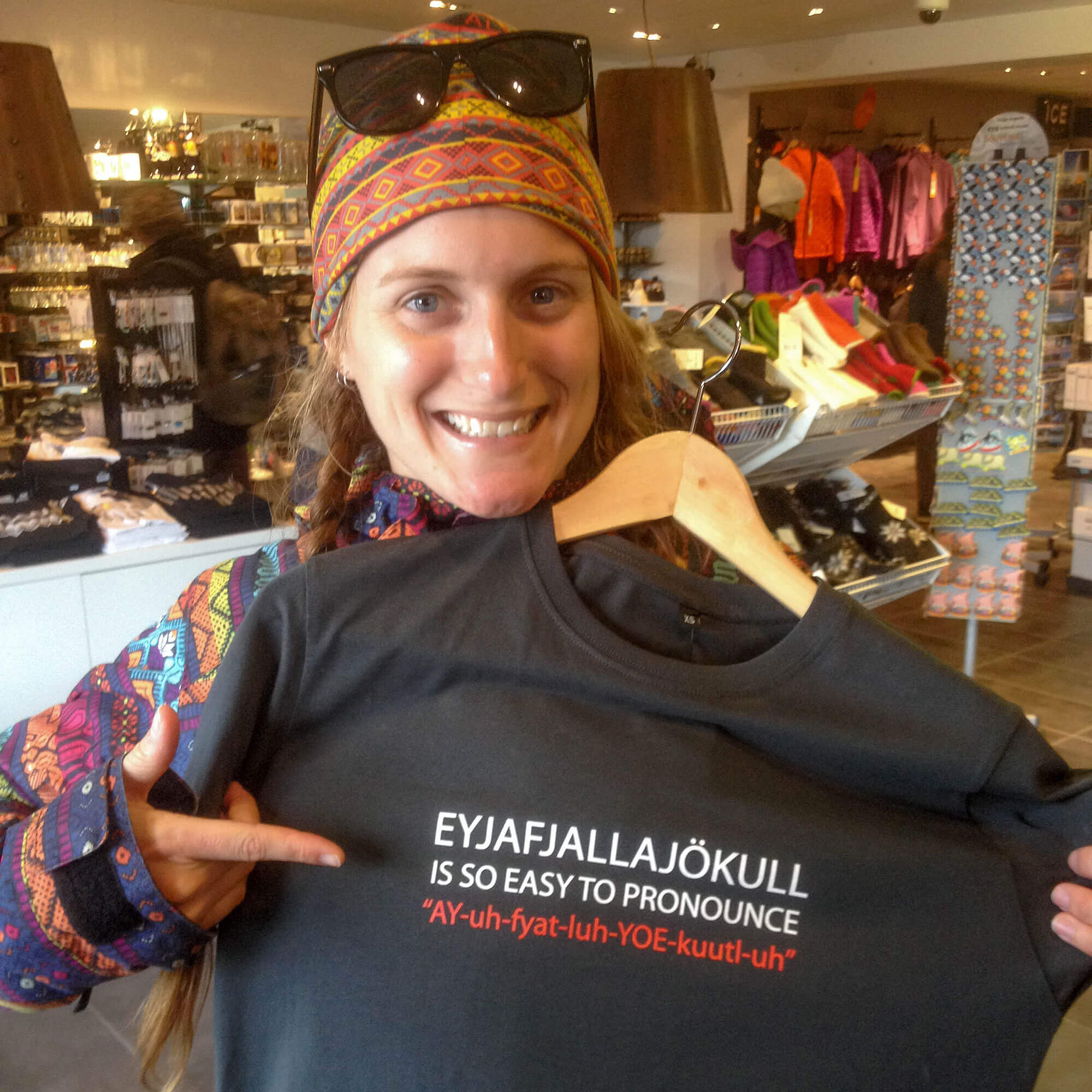 Ali and Funny Icelandic t-shirt in Souvenir shop in Reykjavik