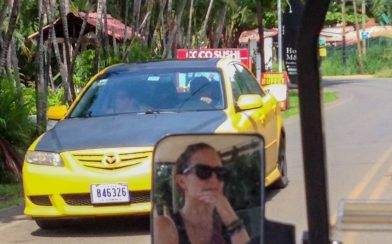 Ali in the Mirror of the Golf Cart while Driving Around Playa del Coco