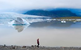 Ali walking by the Glacier Lagoon in Iceland