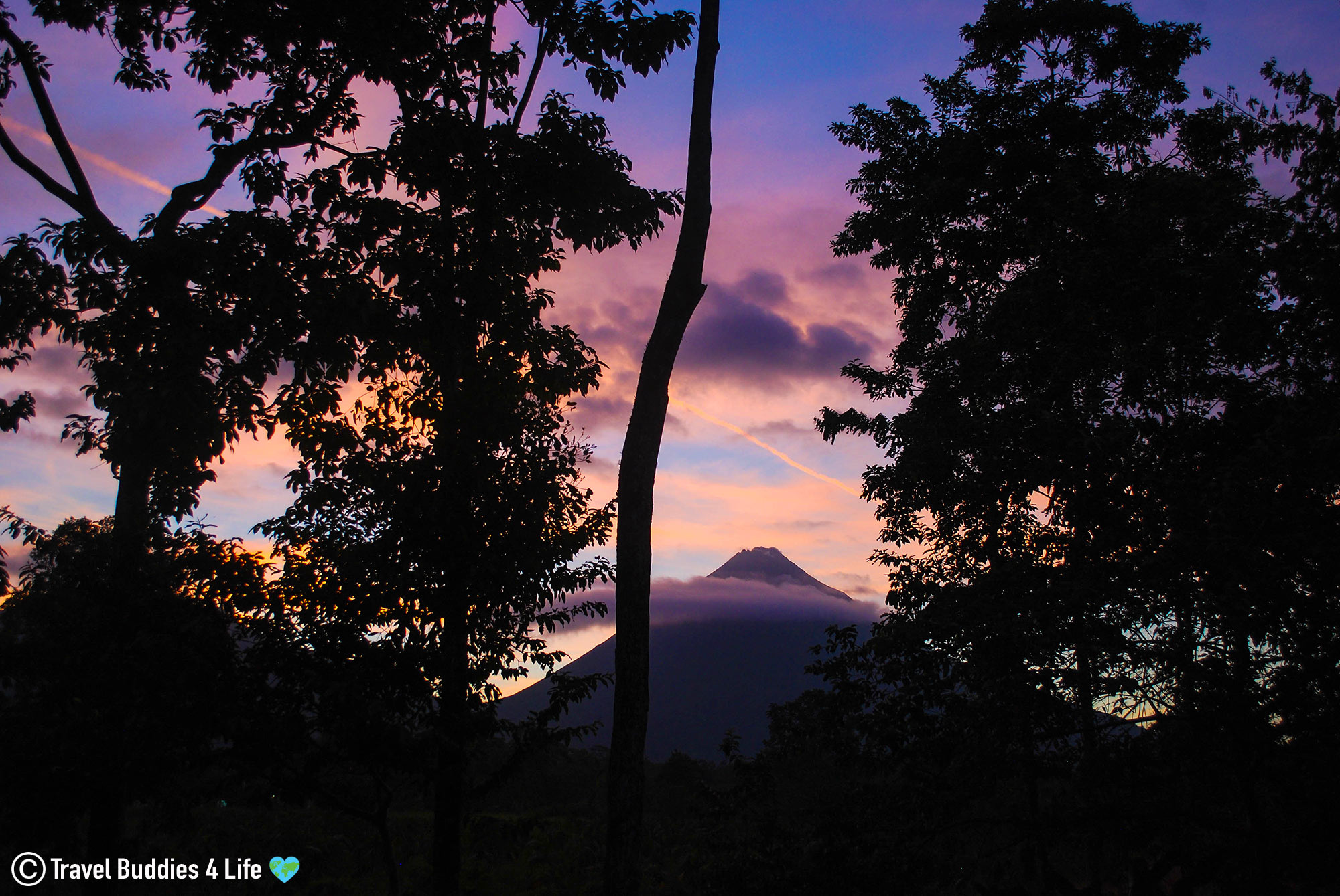Arenal Volcano With Tree's And Purple Sky, La Fortuna, Costa Rica