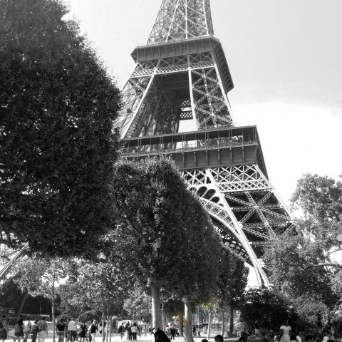 B&W of Ali at the Bottom of the Eiffel Tower