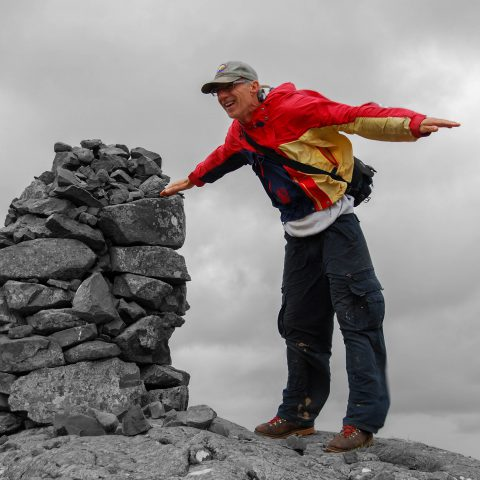 B&W of Dad by the Wishing Rock showing off the power of the Icelandic wind