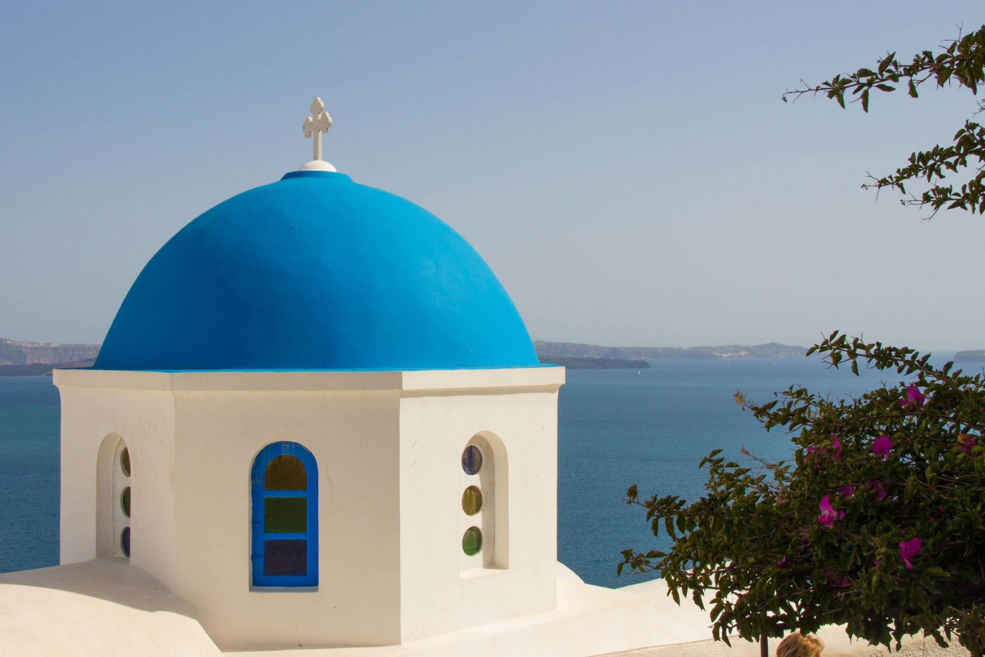 Blue Dome Of A Church On Santorini