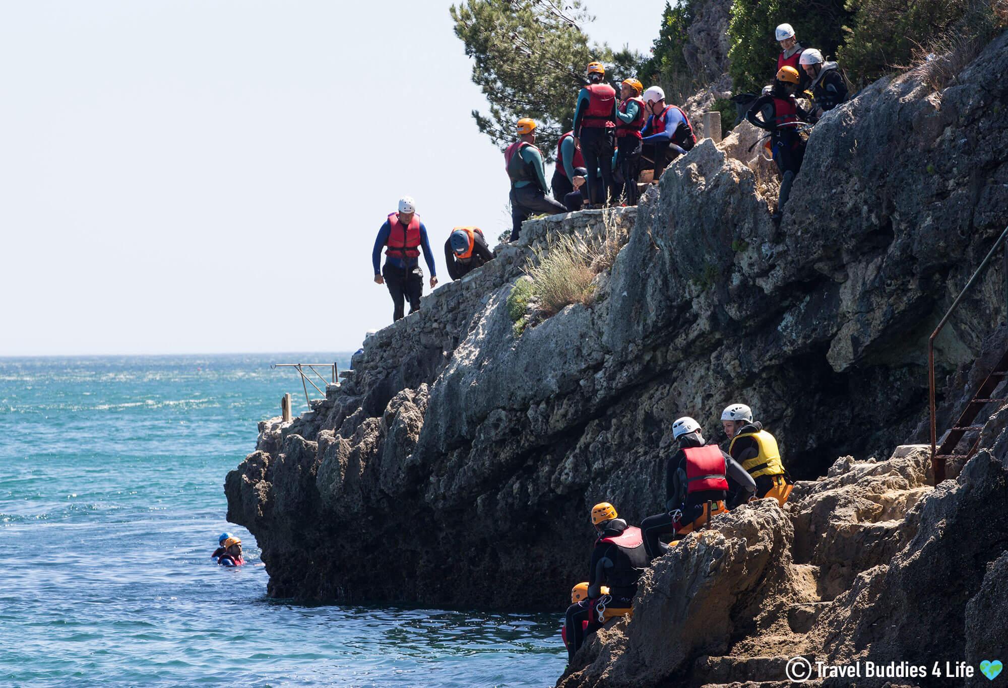WIND Group Sitting on the Serra da Arrábida coast ready to Cliff Jump