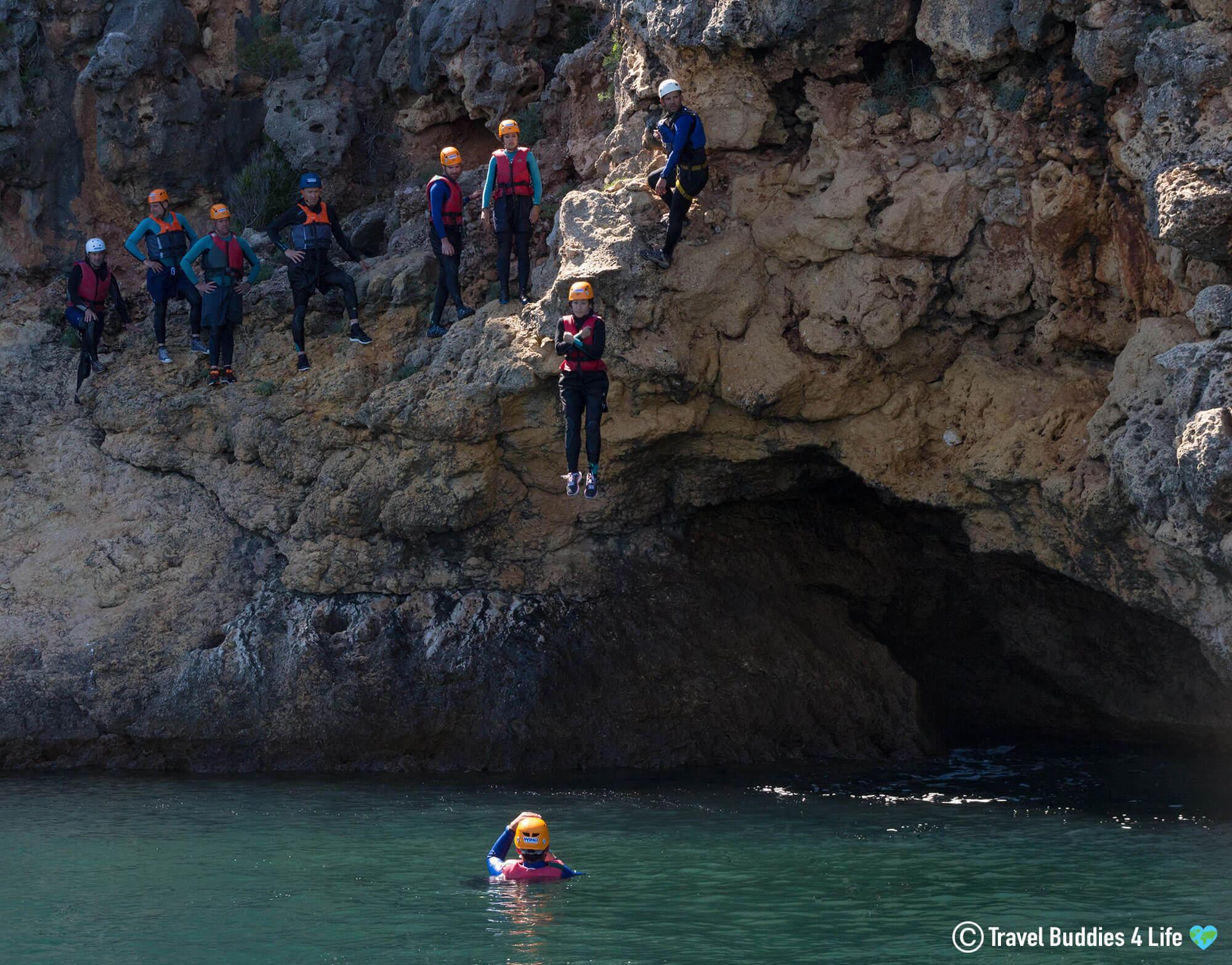 Cliff Jumper Entering the Water as WIND Coasteers the Serra da Arrábida Natural Park