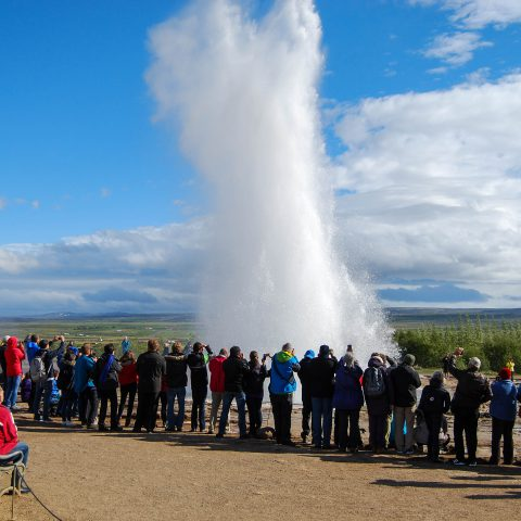 Group of People Around the Exploding Geysir in Iceland