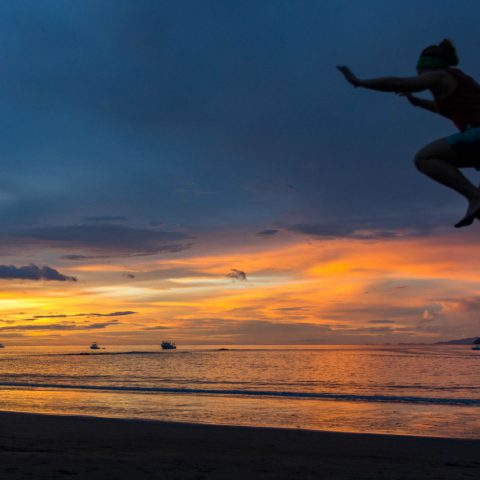 Ali Jumping off the Dock at Sunset in Playa del Coco