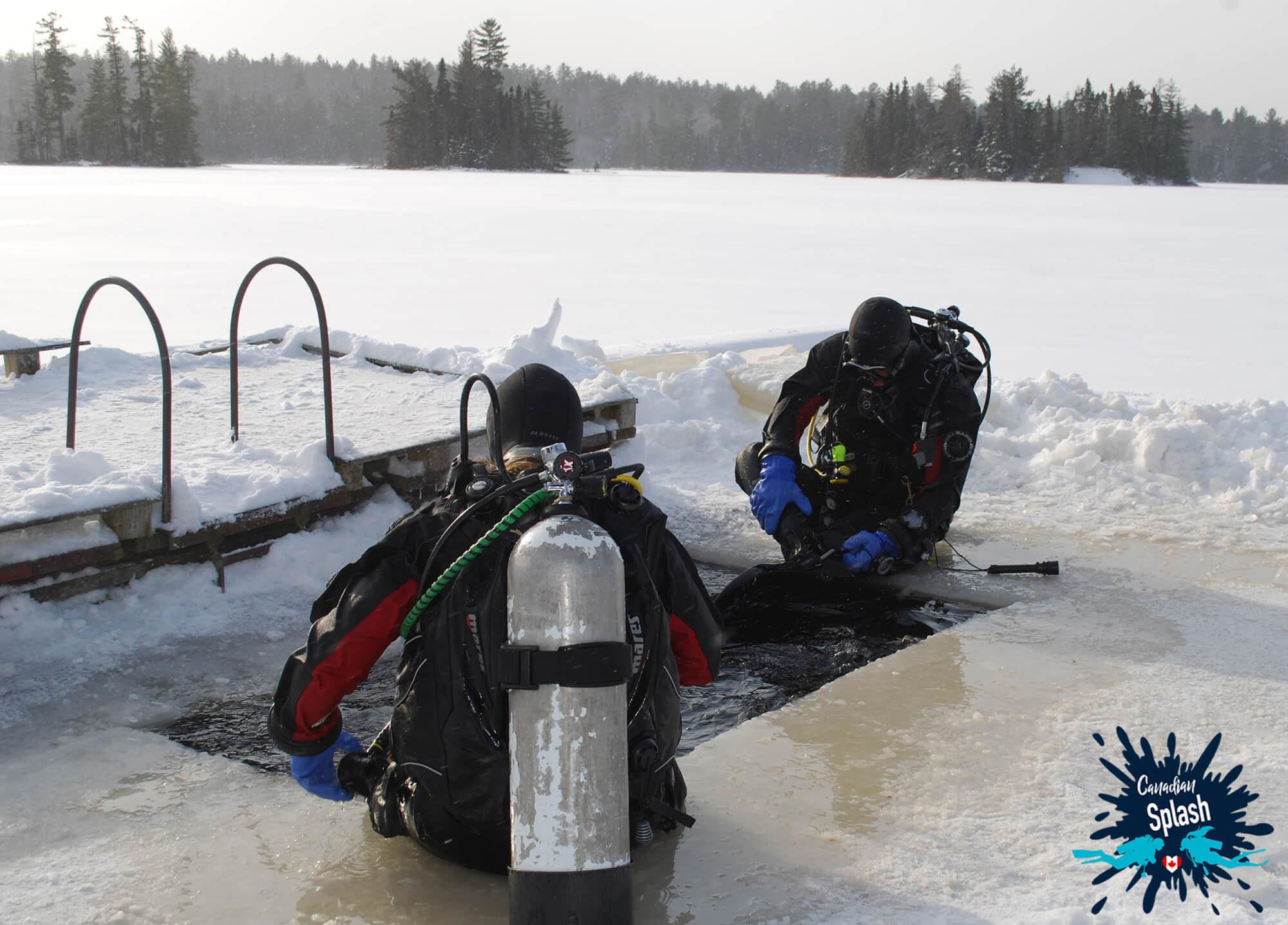 Dive Buddies Ali and Joey Scuba Diving in the Ice in Northern Ontario, Canada
