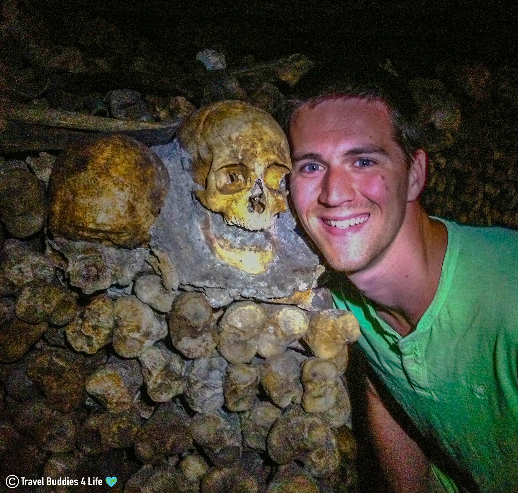 Joey Beside The Discarded Skull In The Crypt Of The Catacombs In Paris, France