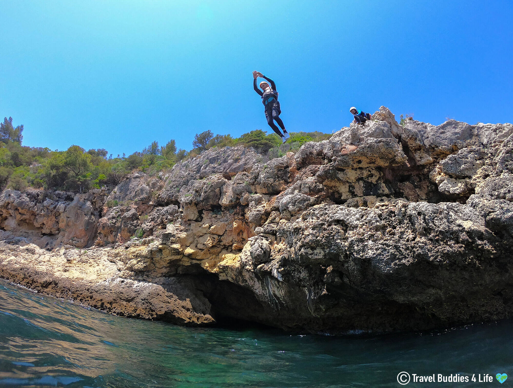 Joey Jumping from the Top of the Cliff on our Coasteering Adventure in Portugal