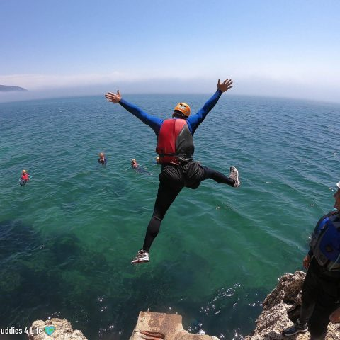 Joey Leaping off a Rock While Coasteering in the Arrábida Natural Park, Portugal