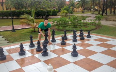 Joey Playing Chess at the Resort in Cuba