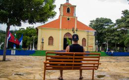 Joey Sitting at a Colorful Church