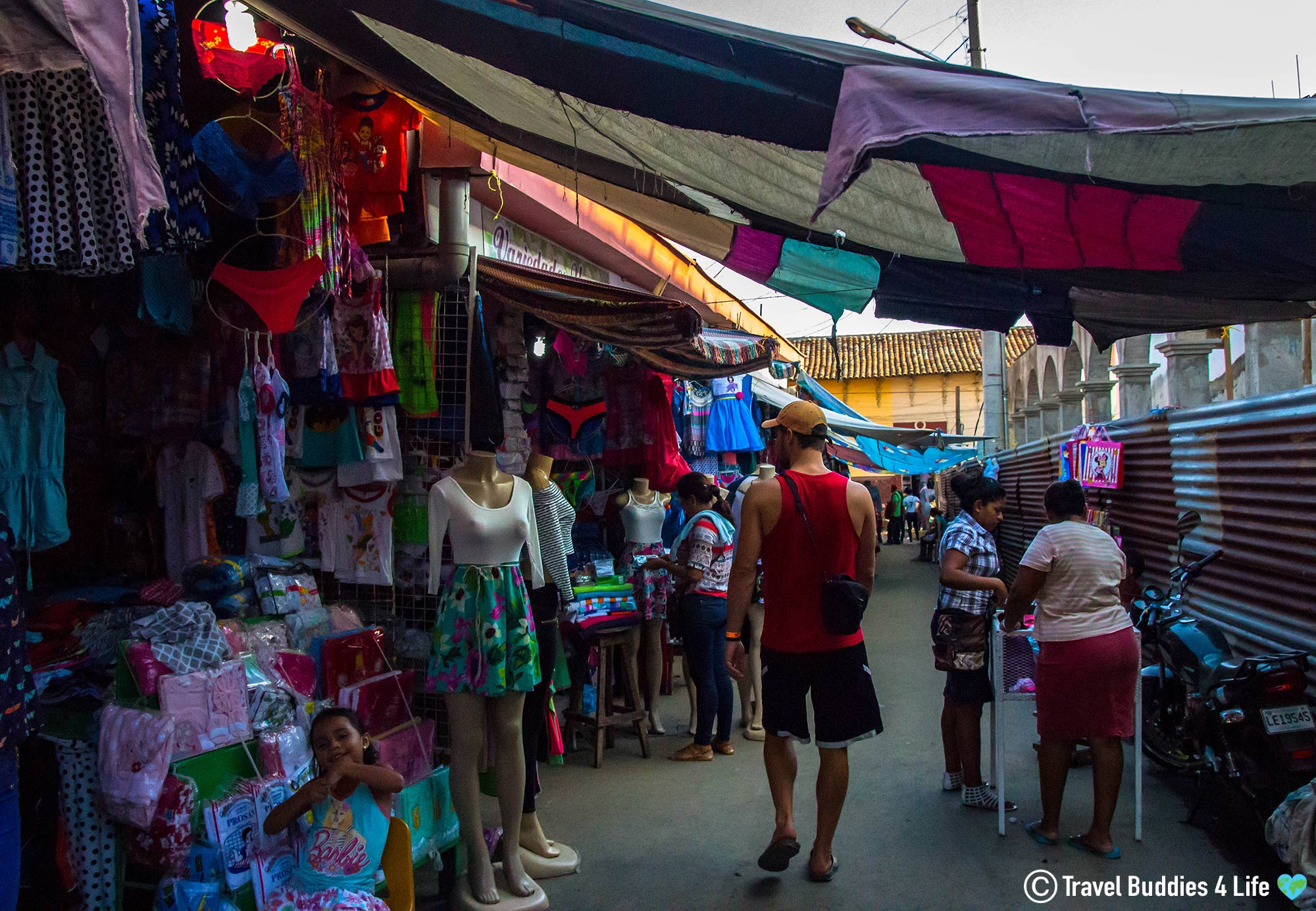 Joey Walking Amid The Colourful Shops In The Caribbean
