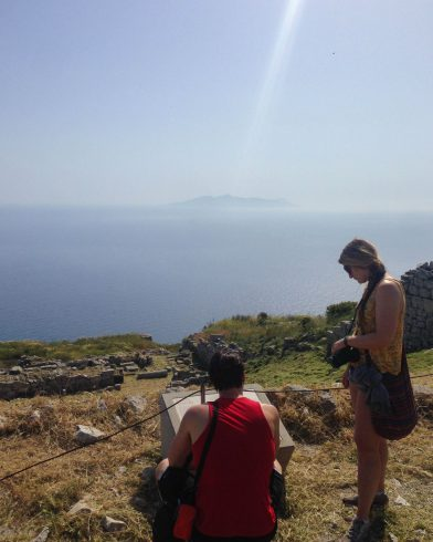 Joey And Ali Looking At The Thera Ruins Information Panel On Santorini, Greece
