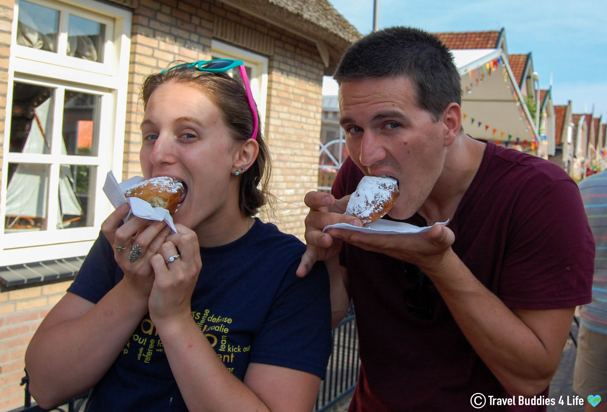 Joey And Ali Sinking Their Teeth Into The Delicious Oliebollen Dutch Treat, The Netherlands