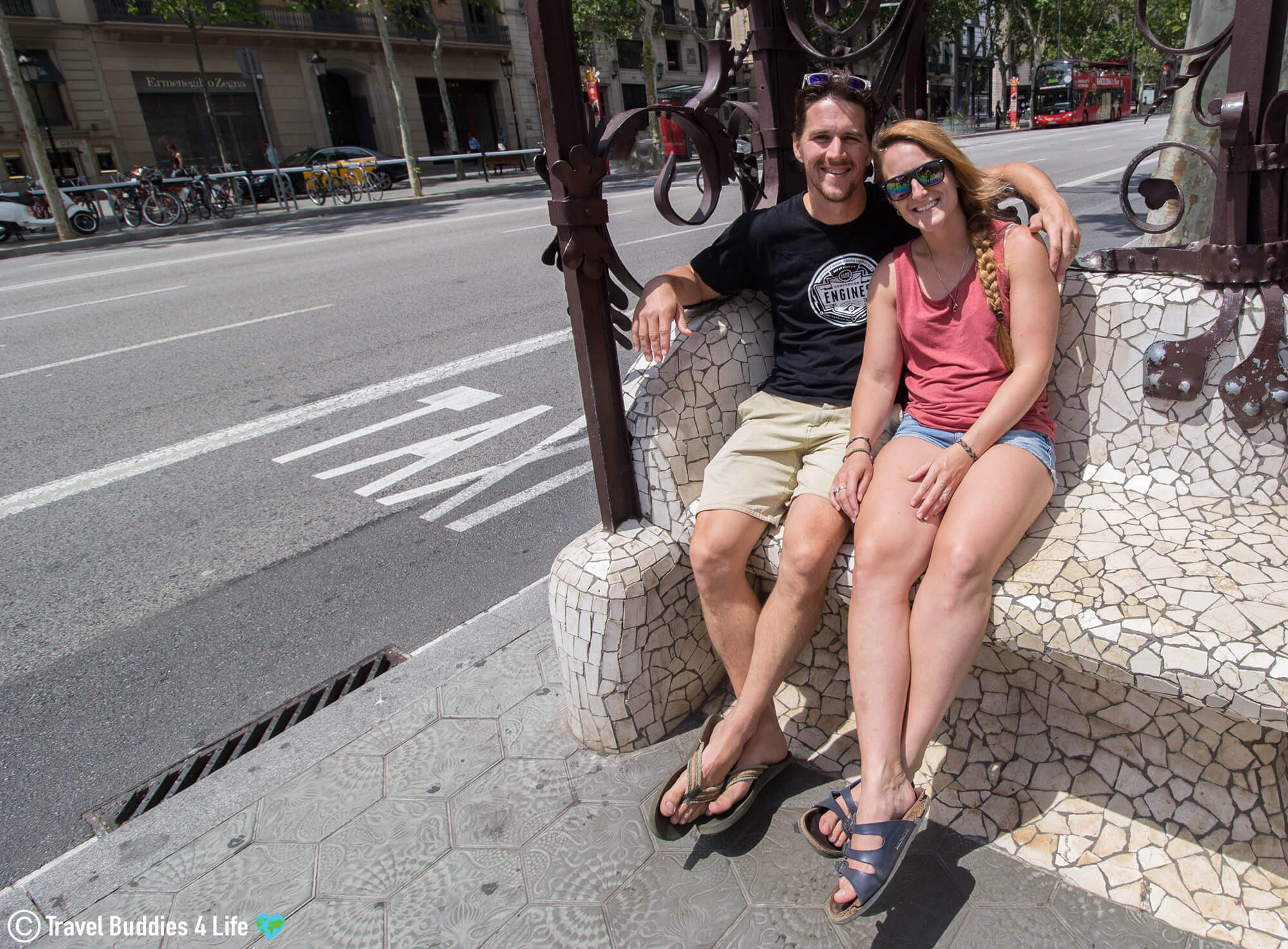 Joey and Ali Sitting in one of the Mosaic Bus Chairs in Barcelona, Spain