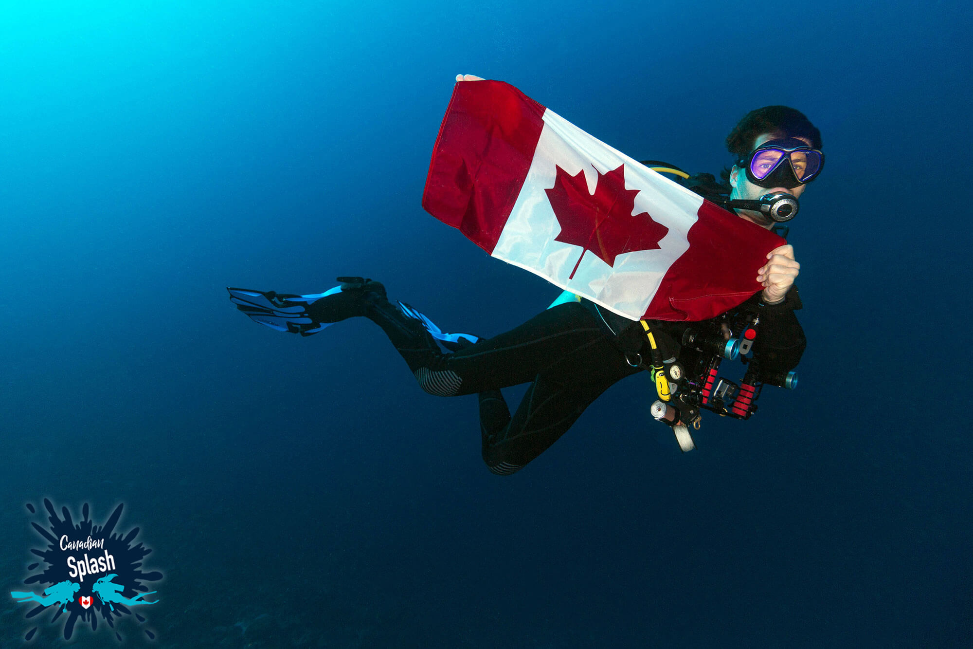 Joey Scuba Diving with a Canadian Flag for Canadian Splash
