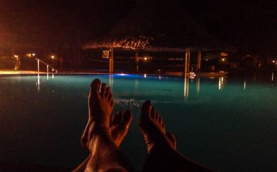 Laying by the Resort Pool at Night