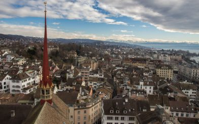 Looking Over The City Of Zurich With A Church Steeple In The Picture