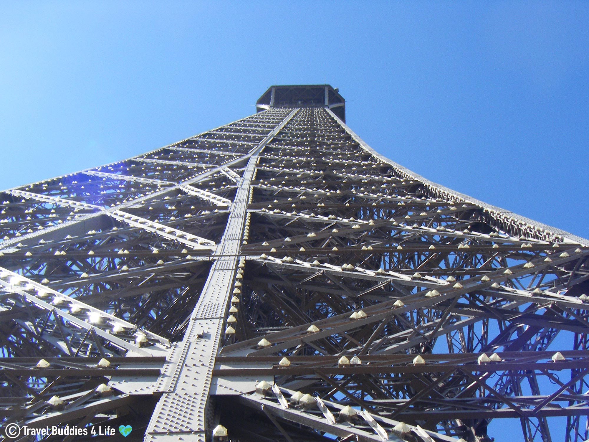 Looking Up The Metal Lattice Of The Eiffel Tower, Paris, France