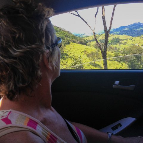 Mom Looking out the Rental Car Window as we Get Around Costa Rica