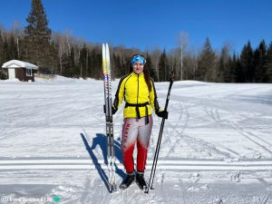 Nadine Standing with her Ski's and Sunscreen on her Face