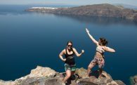 Nadine And Ali At The Edge Of A Cliff In Santorini