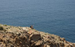 Nadine At The Edge Of A Cliff On Santorini Island