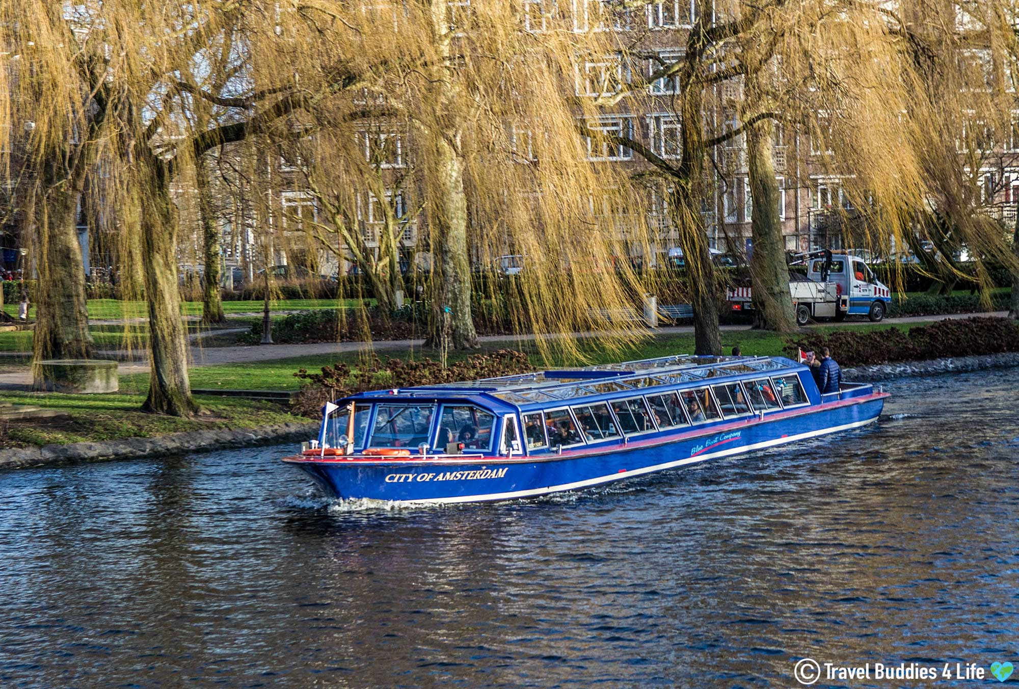 Netherlands Canal Cruise Boat On The Water In Amsterdam, Holland, Europe