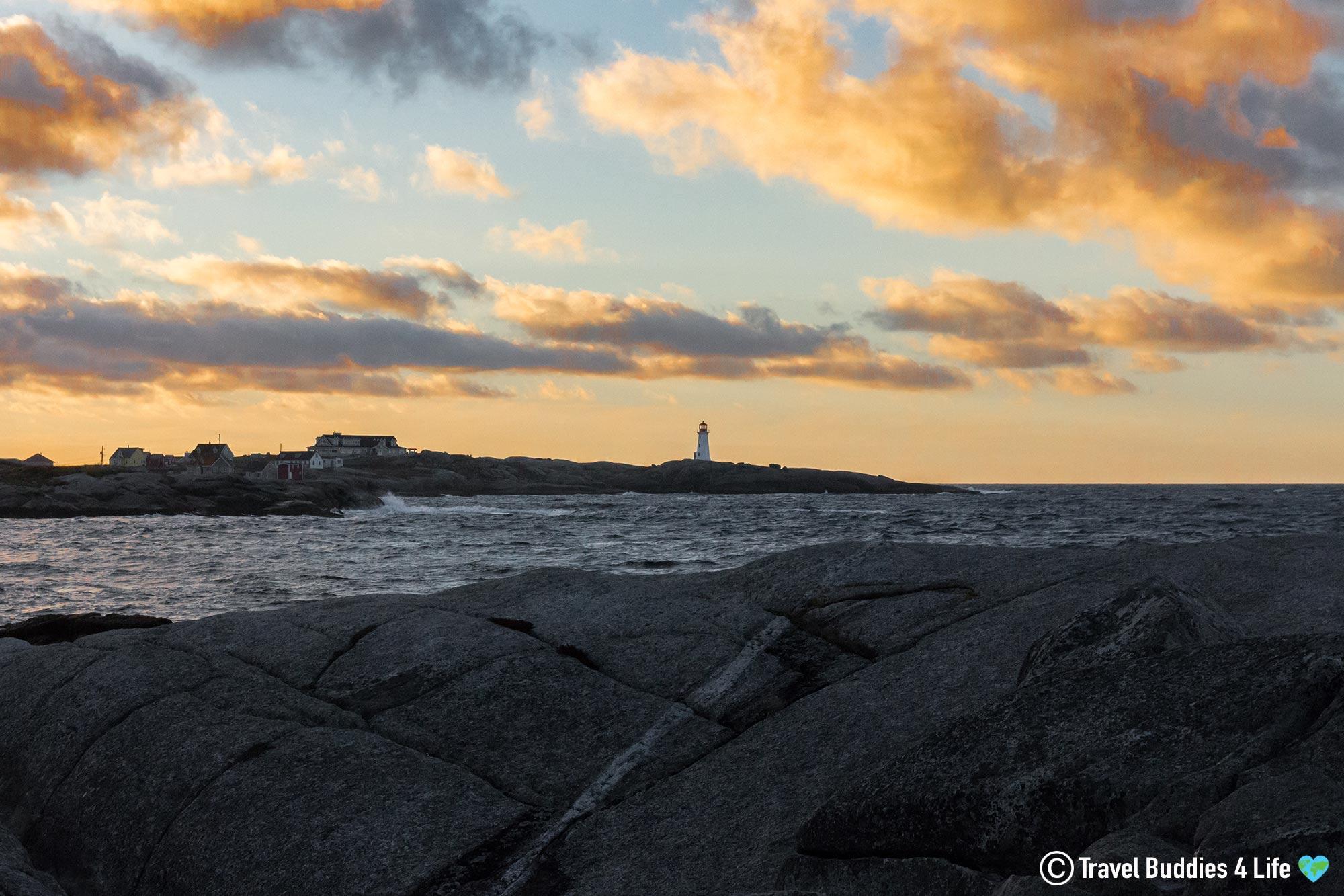 Peggy's Cove Lighthouse Under The Orange Glow Of The Sunset, Halifax, Nova Scotia