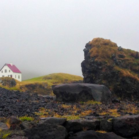 A Small Red Top House in the Icelandic Fog