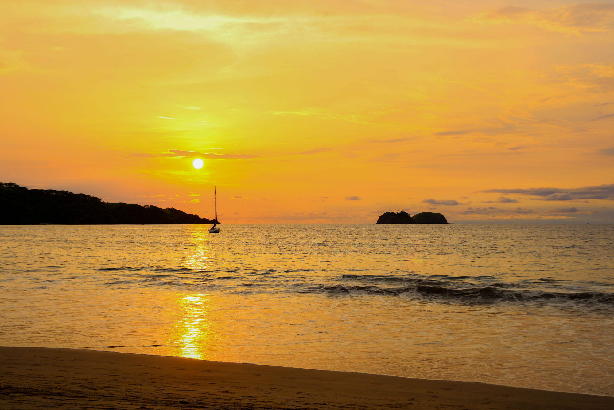 A Sail Boat and Sunset from Playa Hermosa, Costa Rica