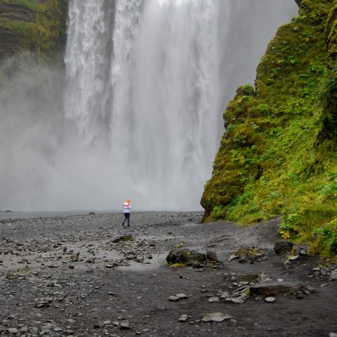 Iceland's Skogafoss with Ali Walking at the Bottom