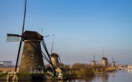 Some Kinderdijk Windmills In The Horizon Of The Netherlands