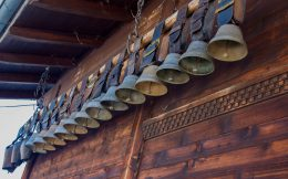 Some Swiss Cow Bells Hanging On A House