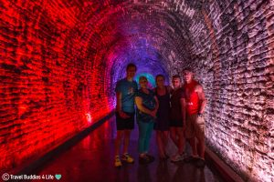 The Family Walking The Disco Coloured Inside Of The Train Tunnel In Brockville, Ontario, Canada