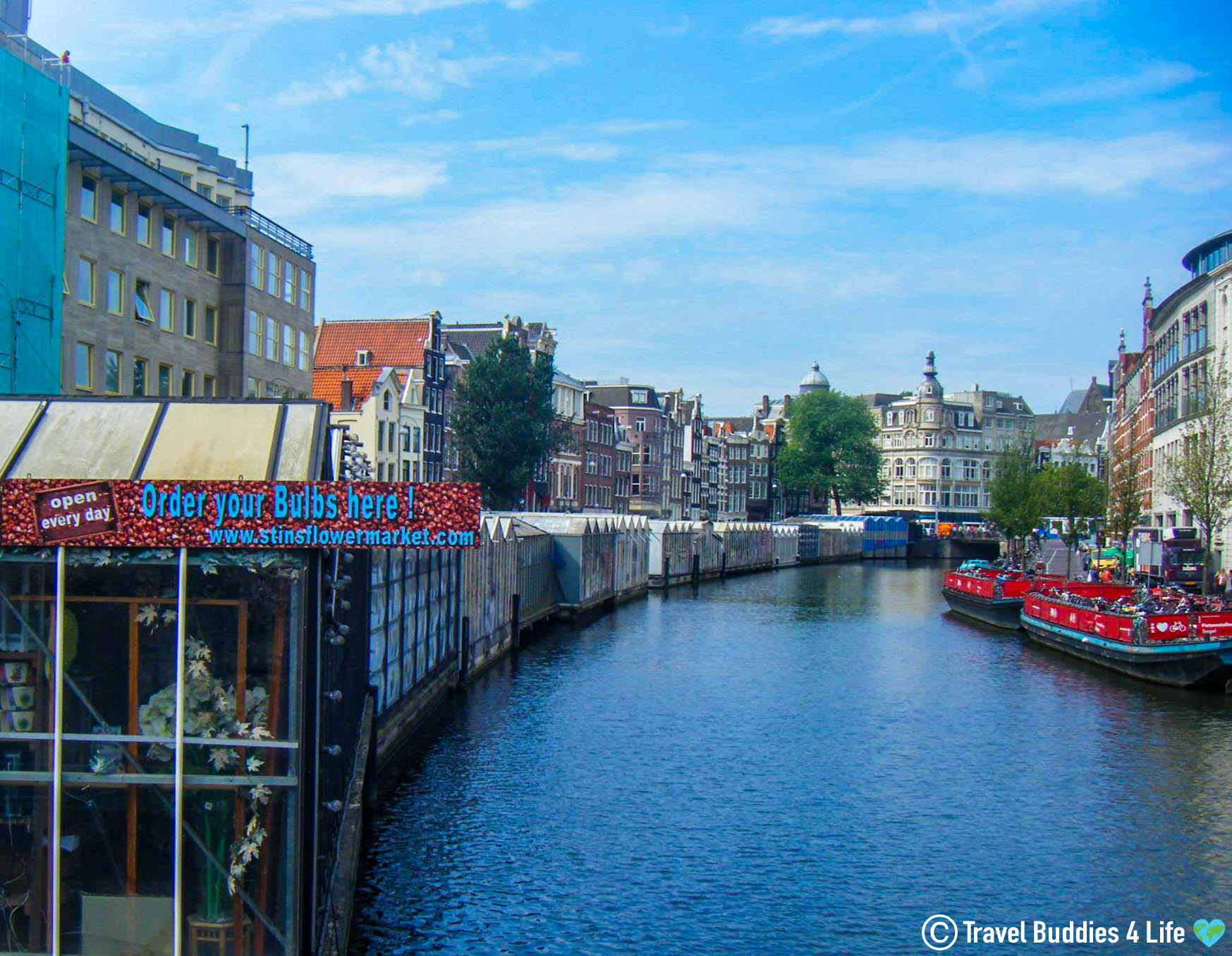 The Floating Tulip Market On A Canal In Amsterdam, Netherlands, Europe Traveling