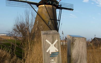 The Kinderdijk Post With A Windmill