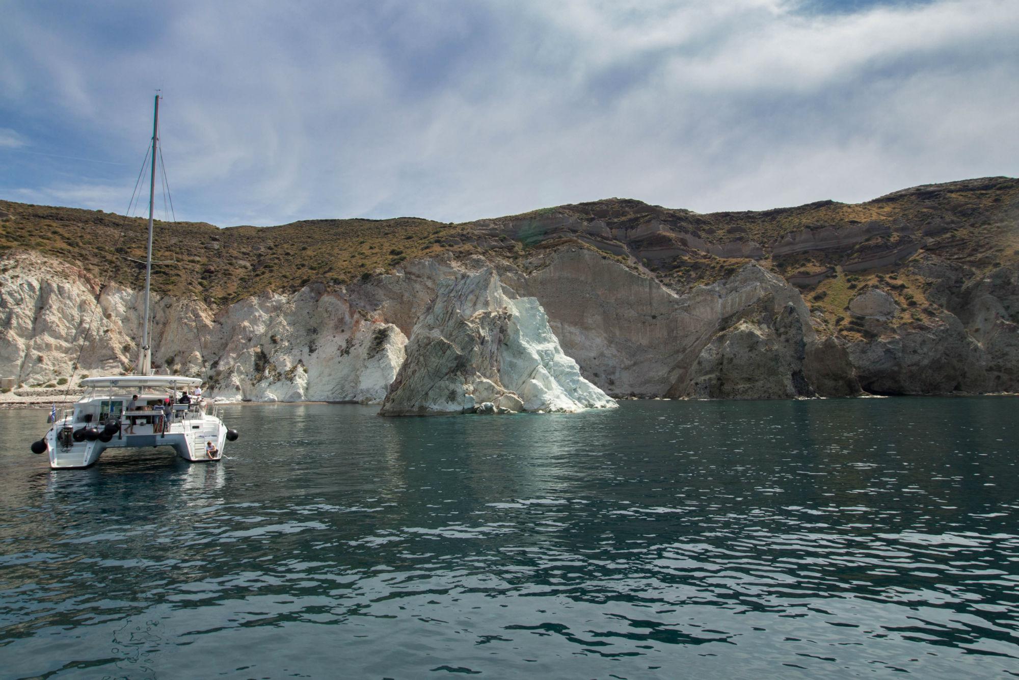 The Rear Of A Sailboat Anchored Near The White Beach