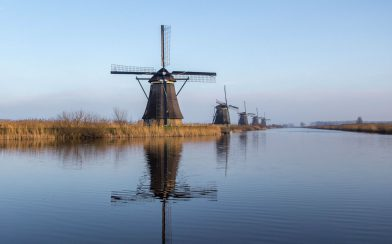 The Reflection Of The Kinderdijk Windmills On The Canal Water