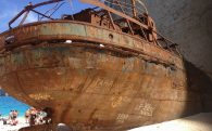 The Stern Of The Rusted Shipwreck On Navigo Beach